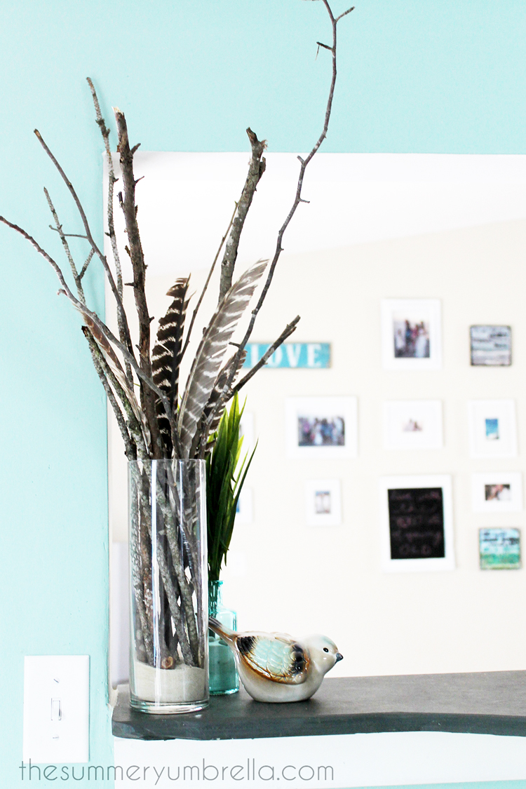 Add a few feathers to your DIY tree branch centerpiece to make it extra special!
