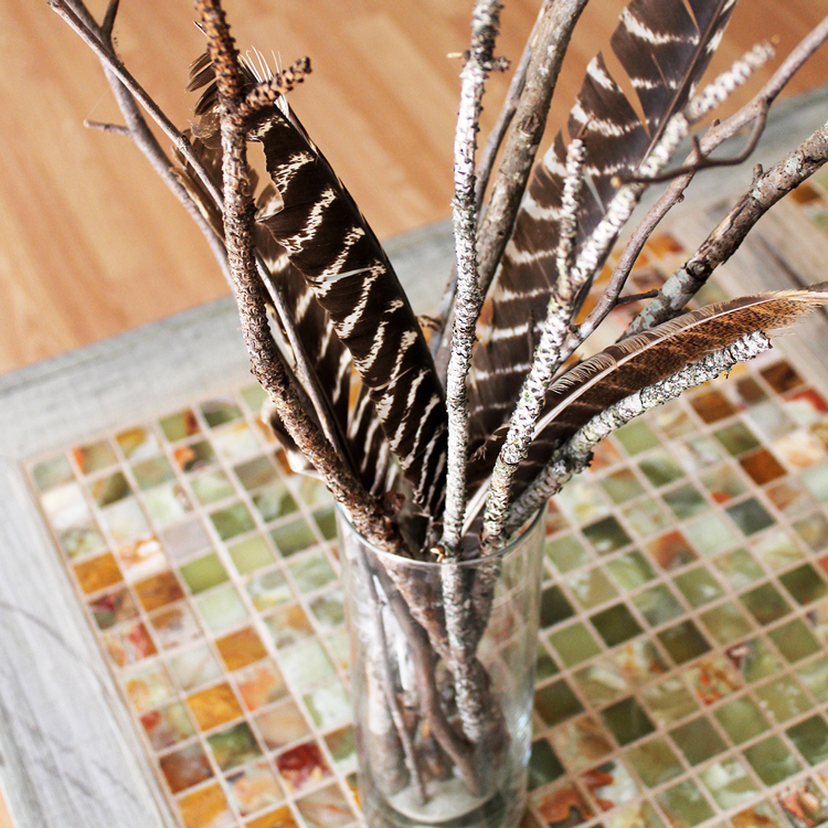 An easy DIY branch centerpiece is all you need to bring a little nature into your home. Check out a few of my favorites now! #centerpiece #naturaldecor #thesummeryumbrella
