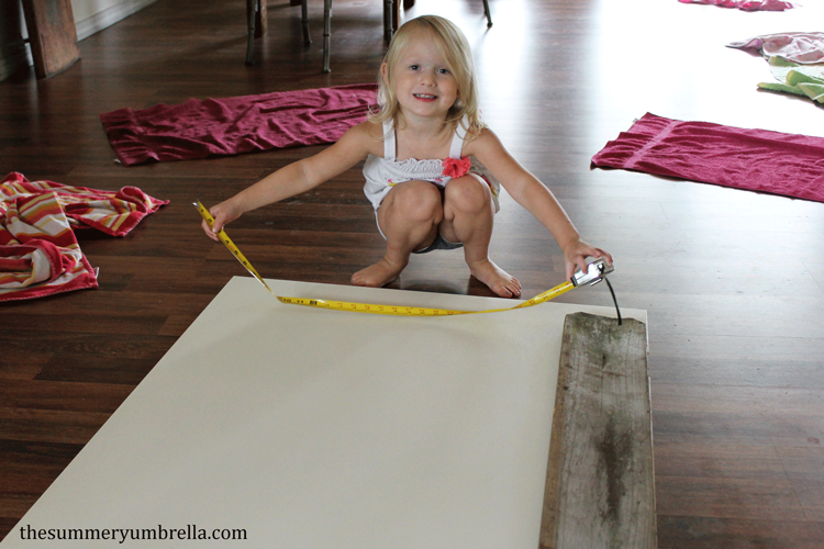 It's nice to have your little helper around when you're doing DIY projects like this reclaimed wood paneled door!