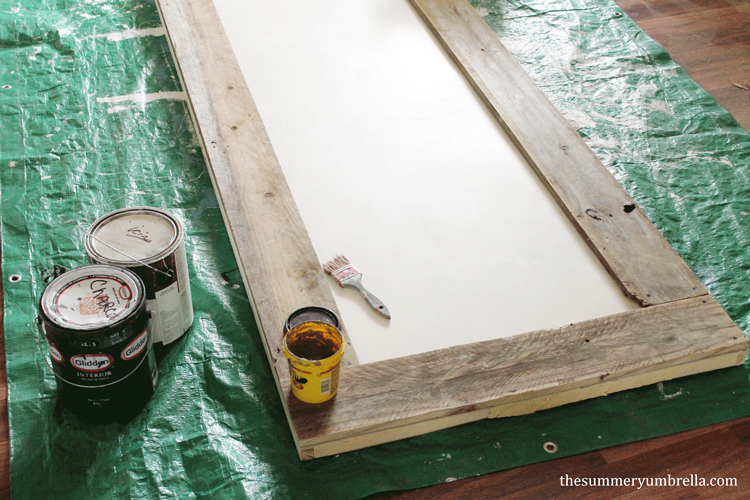 Designing your own custom DIY reclaimed wood paneled door doesn't have to be a chore. Let me show you how to make one now!