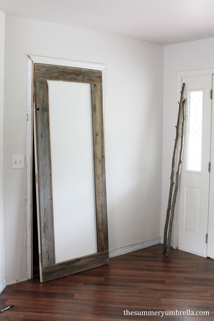 This beautiful DIY reclaimed wood door is not only unique and interesting, but super simple to create as well!