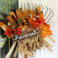 All you need to make this festive DIY fall rake decor is an old rake, some fall foliage and dried corn to create this beauty!