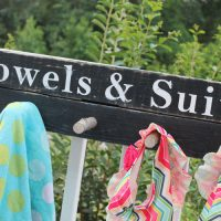 Beach Towels & Suit Sign
