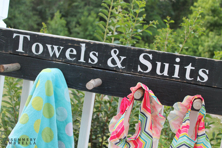 "how to make a wood sign that hangs up towels and bathing suits. This one says ""Towels and Suits."""