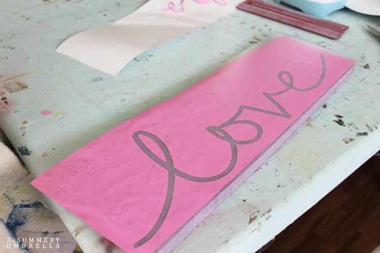 Vinyl stencil that reads love in cursive script