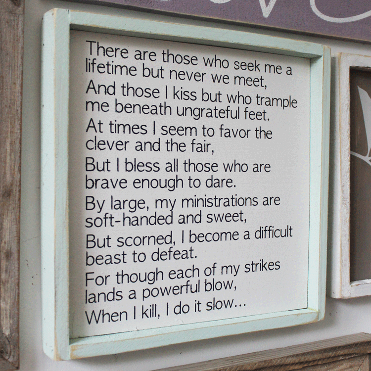 A quote from a book framed in a wood frame