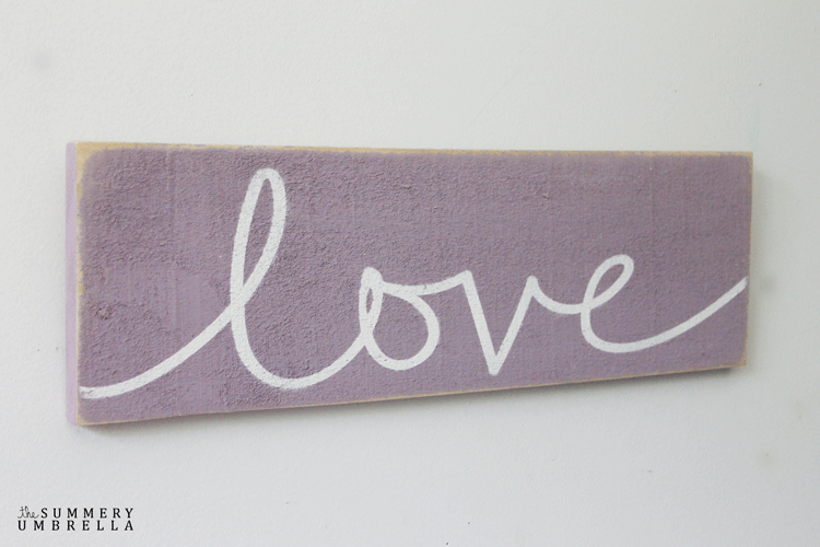 Purple wood sign with the word Love
