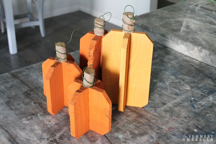 All you need is a few scraps of wood, a branch, wire, and paint to create these super versatile DIY reclaimed wood pumpkins in gray. So easy and pretty too!