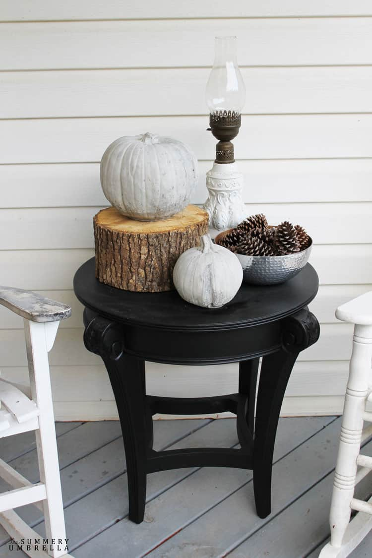 Sometimes all you need is a little bit of paint to completely switch up your space. For example, my new black end table for my front porch. LOVE!