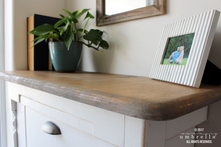 Old wooden end table turned into a DIY hidden trash can