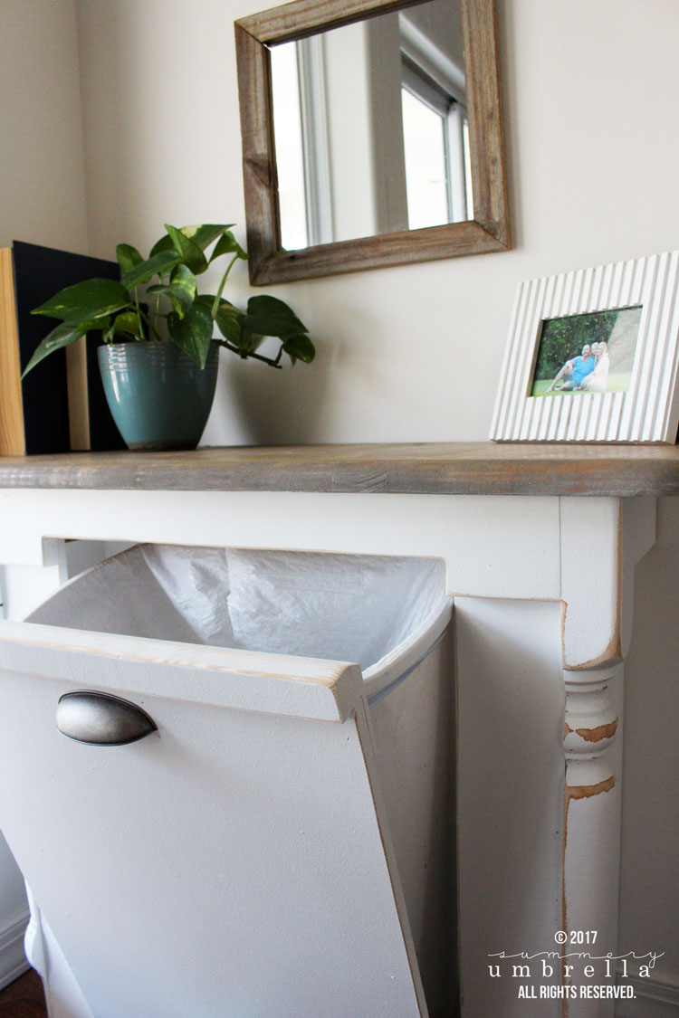 Ever wondered what you could do with that old table you have lying around? Well, you could give it a makeover and turn it into a DIY wood tilt out trash can for your kitchen! #storage #upcycle #TheSummeryUmbrella #LZCathcart