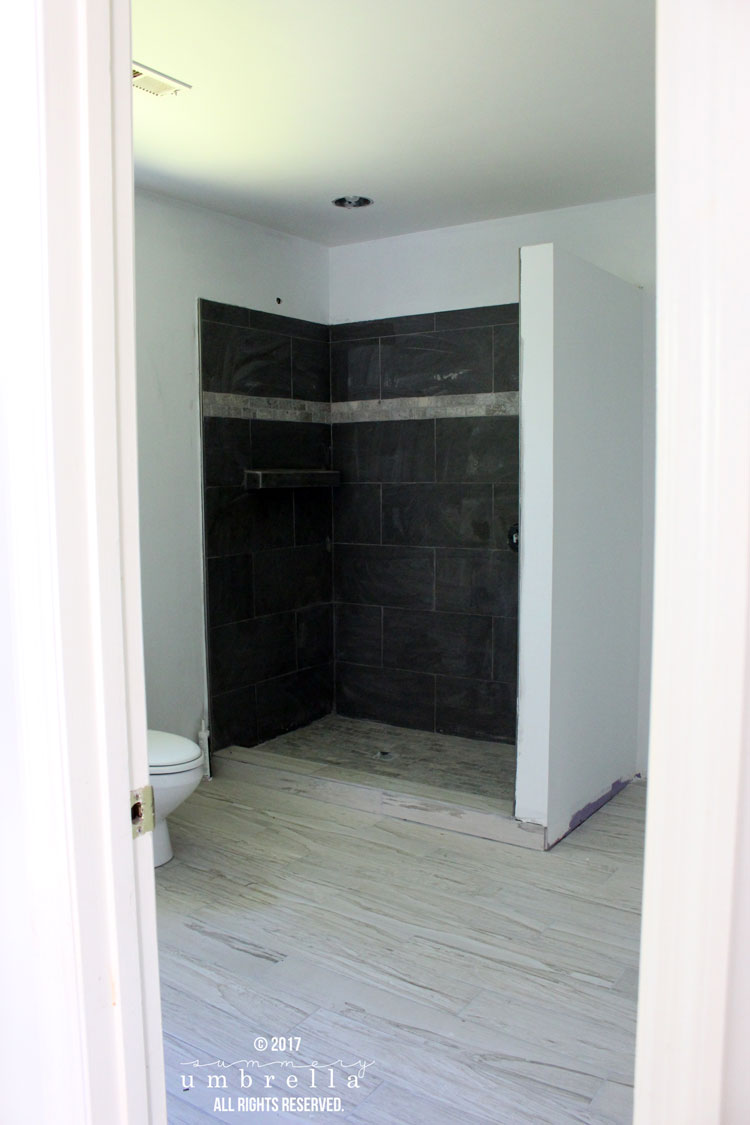 Today I'm sharing my master bathroom remodel update and concept board. The design is super simple, cool, and calming with gorgeous, rustic vanities.