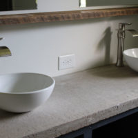 Do you love that gorgeous industrial look of concrete, but not sure how well it would hold up in your bathroom? Let me show you just how easy and quickly you can seal a concrete countertop to get this look ASAP!