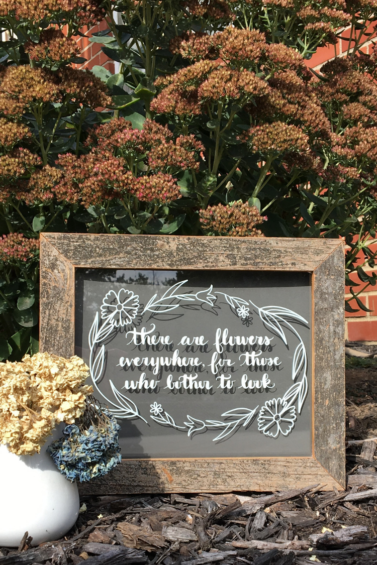 Learn how to make a There are Flowers Everywhere DIY Glass Sign for your home, as a gift for a wedding or any occasion. You can easily make this wall decor from a picture frame or old windows. #vinylprojects #svg #thesummeryumbrella
