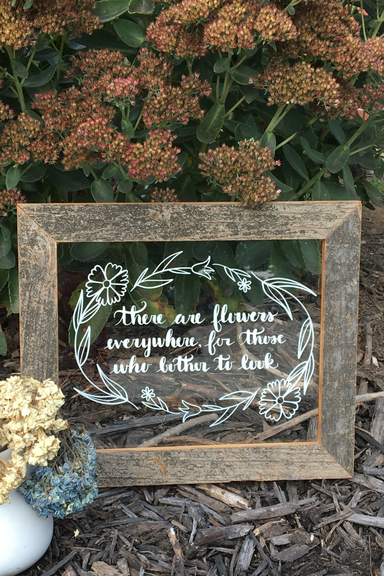 Learn how to make a There are Flowers Everywhere DIY Glass Sign for your home, as a gift for a wedding or any occasion. You can easily make this wall decor from a picture frame or old windows. #cricut #cutfiles #thesummeryumbrella