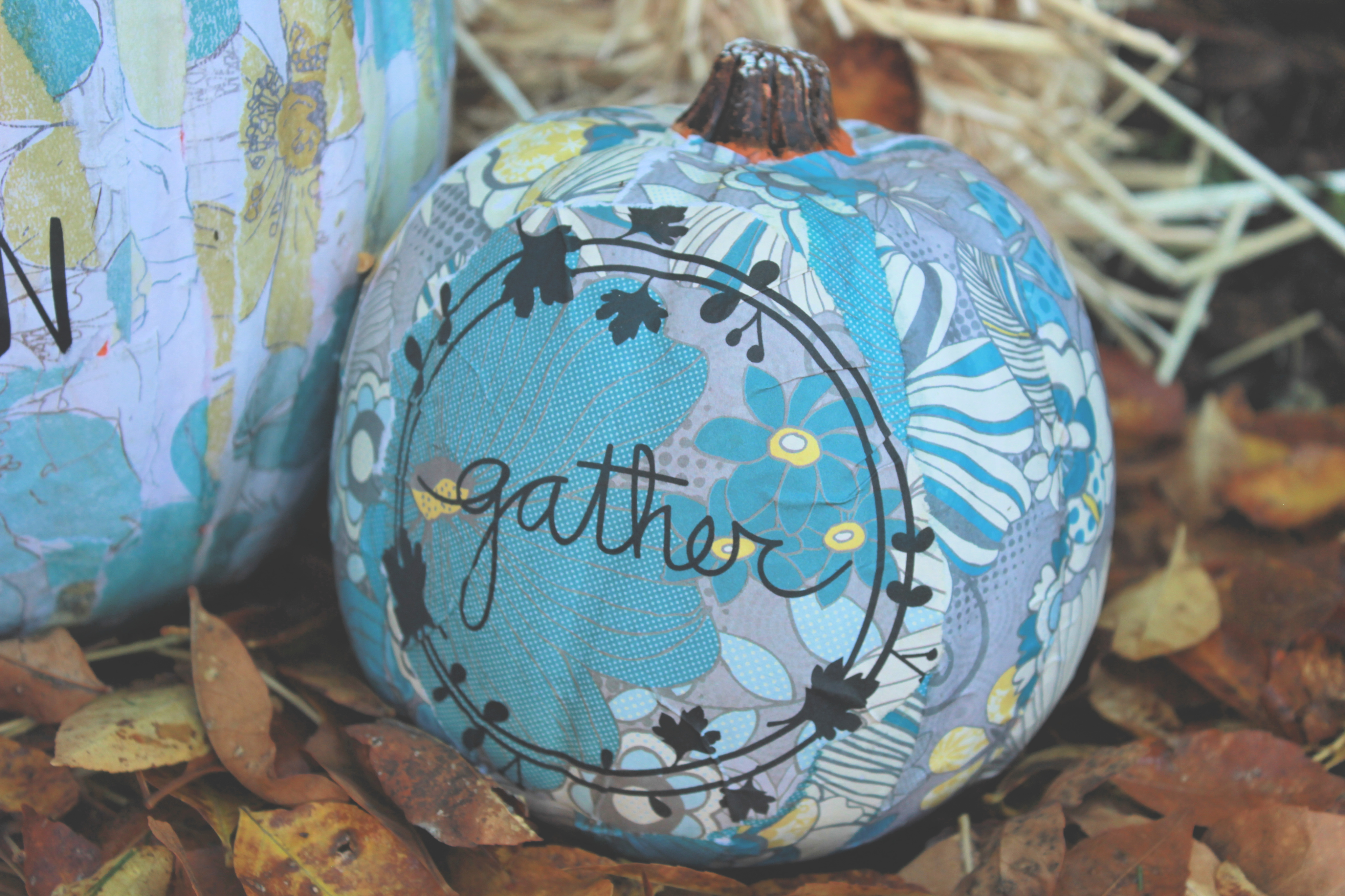 Need ideas for a no carve pumpkin?  Learn how to create beautiful floral Mod Podge pumpkins to celebrate the fall season in this creative tutorial. You're going to love how unique and easy it is for kids and adults! #pumpkins #nocarvepumpkins #fallcrafts #falldecor #pumpkincrafts #scrapbookpaper #thesummeryumbrella