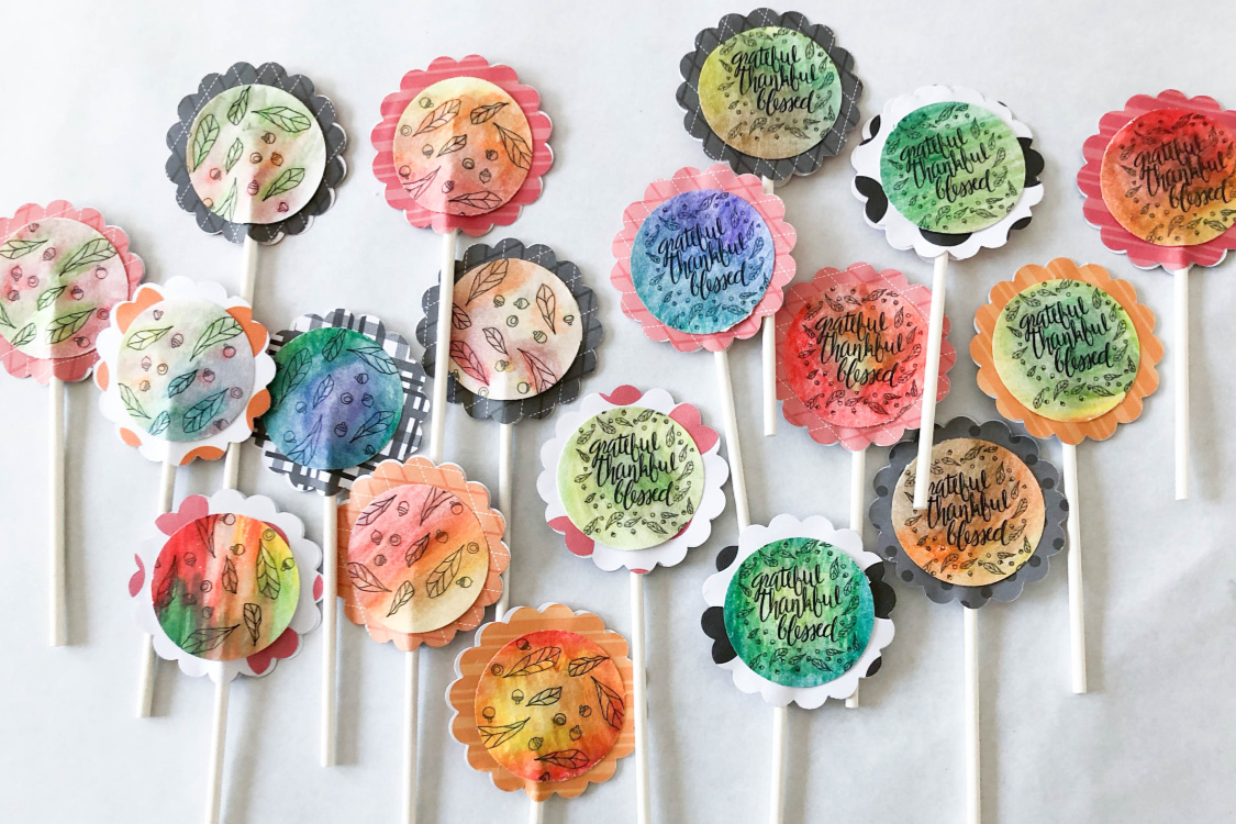 Cupcakes are a fun addition to a birthday party, baby shower, wedding, or any holiday. If you're looking for a way to add pizazz to your cupcakes, learn how to make these beautiful DIY Watercolor Cupcake Toppers from any printable graphic. Click through to see the video tutorial! #cupcakes #cupcaketoppers #thesummeryumbrella