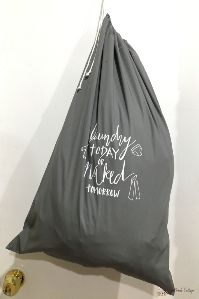 This DIY pillowcase laundry bag is an earth-friendly way to store dirty clothes when traveling and can double as a wash bag for fine washables! #cricut #svgfiles #thesummeryumbrella
