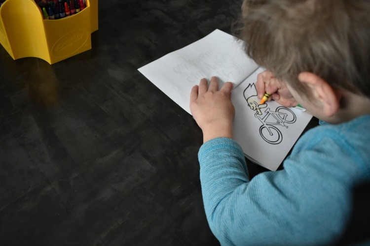 kids coloring on DIY coloring book