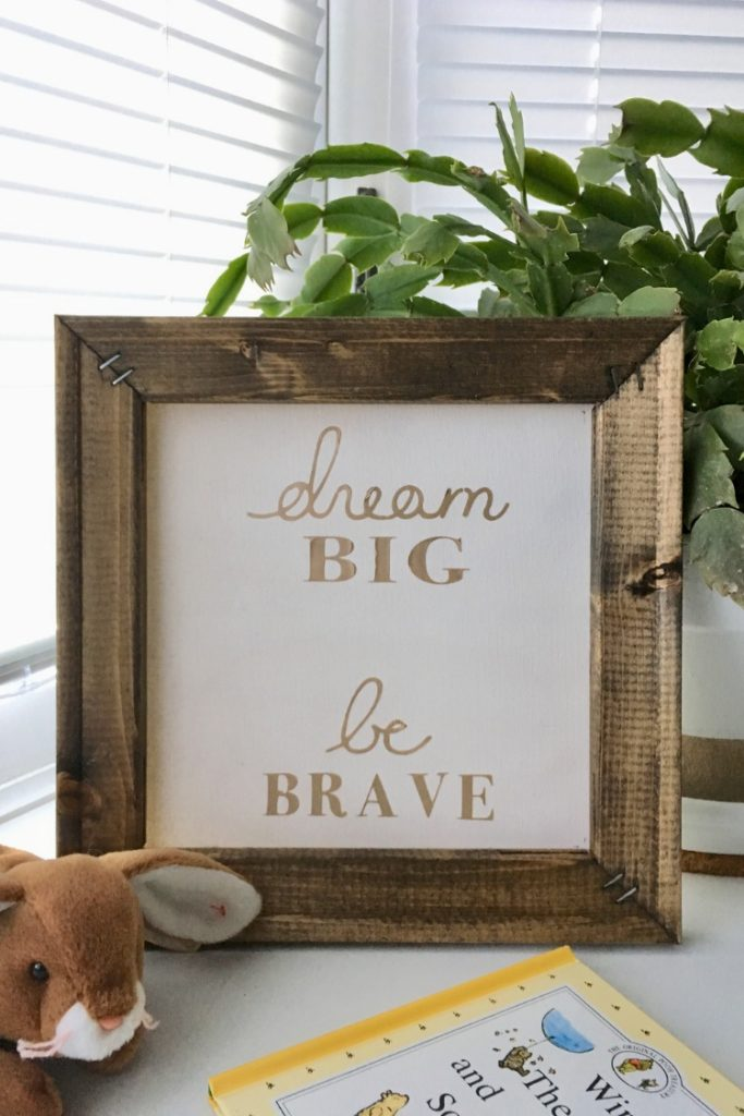 Learn how to make a reverse canvas sign or wall art using an artist canvas, some paint or stain, heat transfer vinyl, and an SVG design for your Cricut or Silhouette with this easy DIY tutorial. #cricutcrafts #diysigns #thesummeryumbrella
