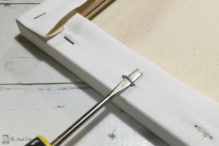 removing staples from canvas for reverse canvas sign or wall art