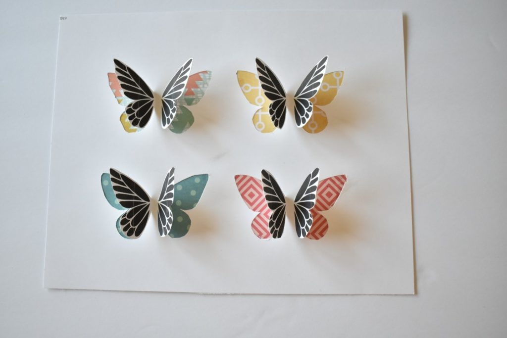 printed butterflies on colorful scrapbook paper