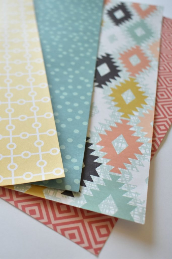 scrapbook paper in 4 different patterns