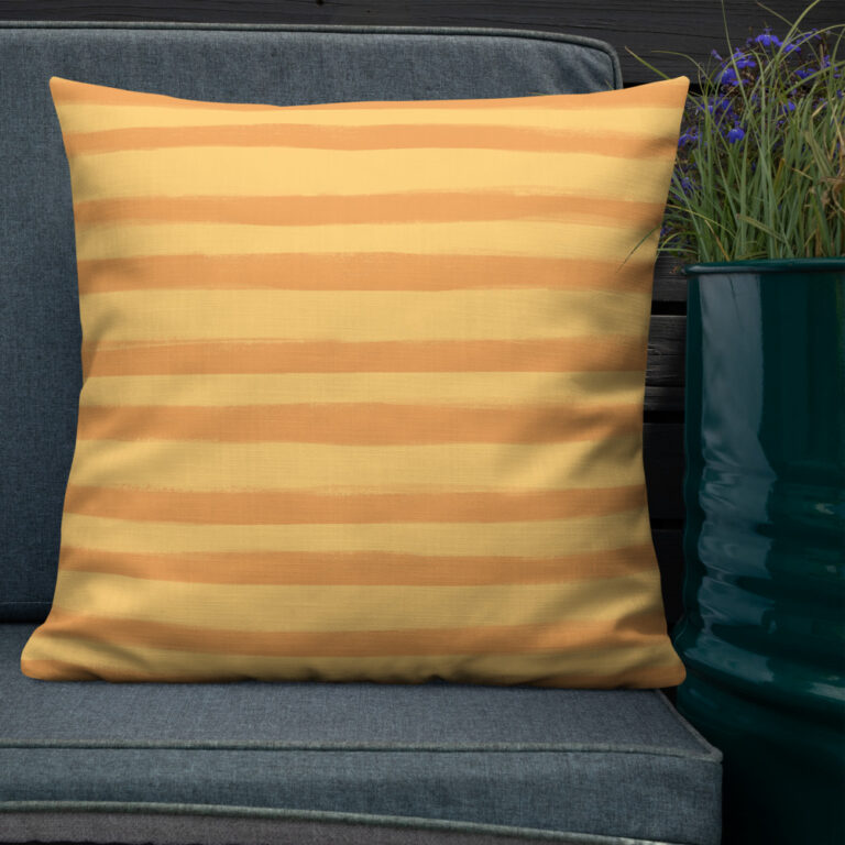 Want to add a splash of color to your home? This Citrus Creamsicle Pillow with a shape-retaining insert is just what you're looking for! #stripepillow #orangepillow #summerdecor