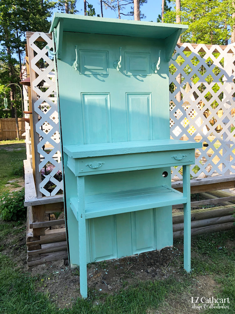 Would you like a potting table without the expensive price tag? Let me show you how to create your own with just a few simple supplies! #pottingtable #potingbench #diypottingtable #diypottingbench #potting #doorpottingtable #doorpottingbench